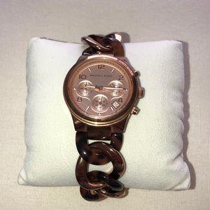 Rose gold and tortoise ceramic bracelet watch